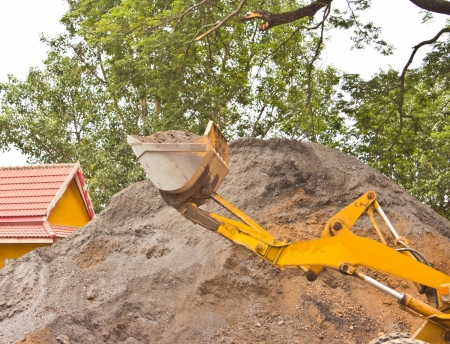Yellow bulldozer was scooping soil photo