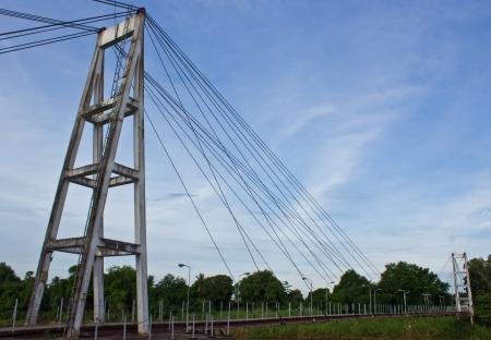 Suspension bridge across the river. photo