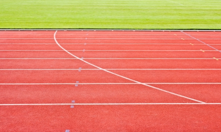 red running tracks with white start numbers at stadium closeup Foto de archivo