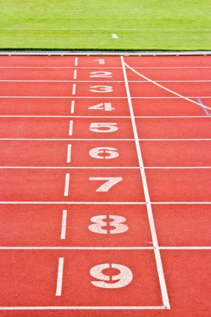 Red running tracks.Numbers one through nine. photo