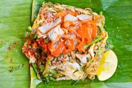Pad Thai noodles on a banana leaf. photo