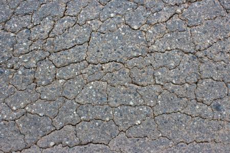 road surface: Macro closeup on concrete asphalt cracks on the road Stock Photo