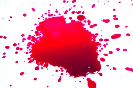 spitting: Red ink drops on a white background