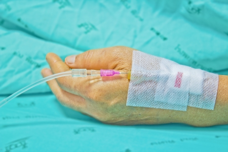 transfuse: Close up of a woman patient in hospital with saline intravenous (iv) Stock Photo