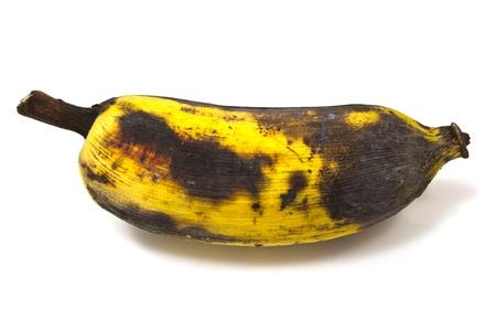a rotting banana isolated on white background photo