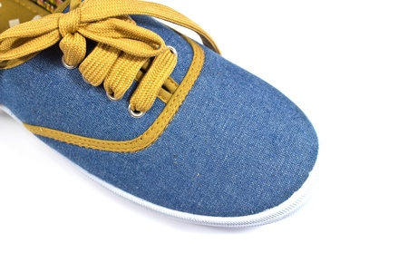 denim shoes on a white background photo