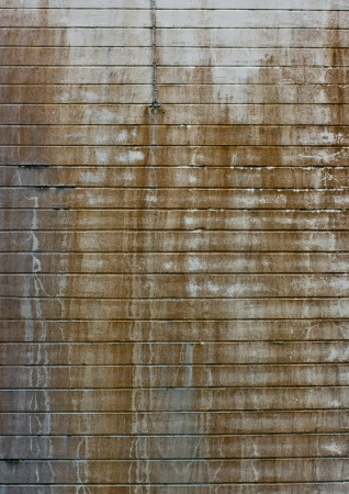 Green dirty super-grunge background. Humid concrete wall with cracks, smudges and stains. photo