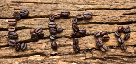 Coffee beans in a letter on the scene  photo