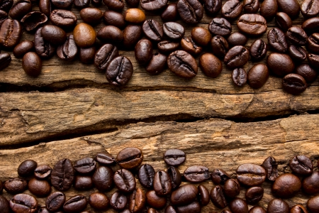 Coffee beans on wood background Foto de archivo