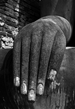 the hands of the Buddha.Sukhothai historical park, the old town of Thailand in 800 year ago photo