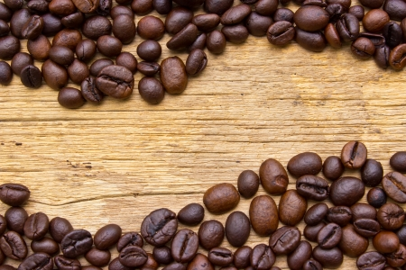 Fresh coffee beans on wood, ready to brew delicious coffee Stock Photo - 23579677