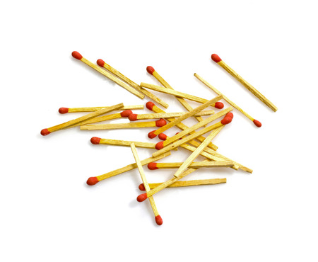 consumable: Close-up of red matches isolated on a white background