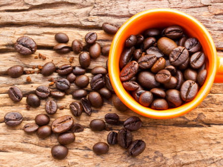 coffeetree: Coffee and cup on grunge wooden background Fresh coffee beans on wood