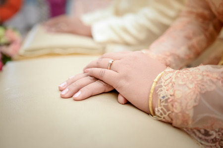 Wedding ring with stone on bride hand photo