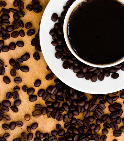 Black coffee and coffee bean on the wooden floor photo