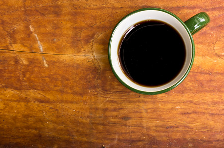 coffeetree: Cup of black coffee  on wooden background. Stock Photo