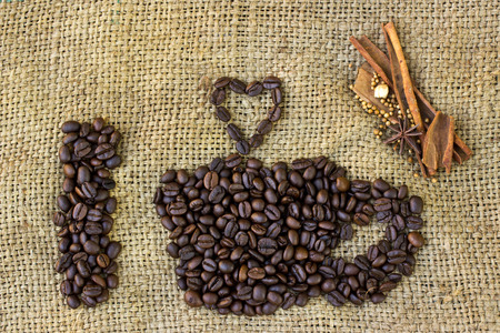 dea: I love coffee symbols made of coffee beans on sack background