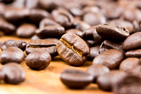 jamoke: Coffee on wooden background Fresh coffee beans on wood ,ready to brew delicious coffee