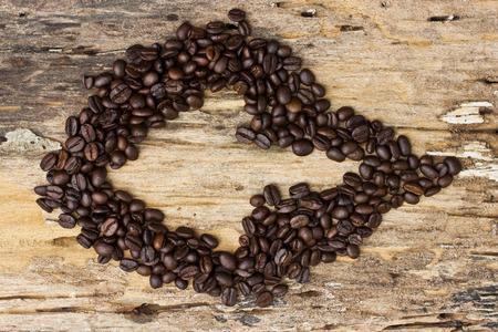 Arrow Coffee beans on the wooden floor photo