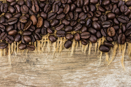 coffee beans on burlap and wood background photo