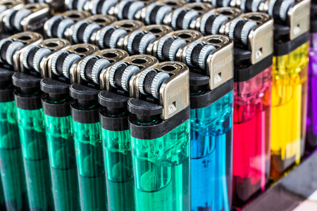 Close up image of a selection of cigarette lighters photo