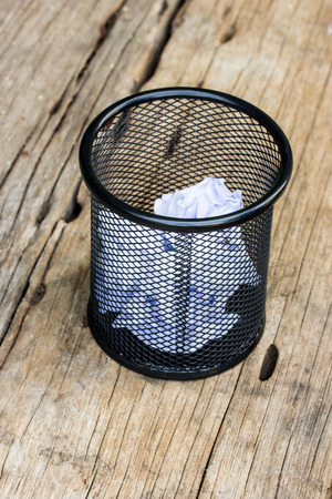 A lot of wrinkled paper laying in basket. Stock Photo