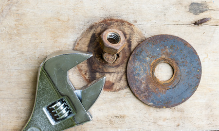 crescent wrench: Wrench and Bolt on wood background