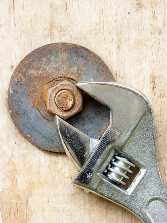 tighten: Wrench to tighten the nut on a wooden. Stock Photo