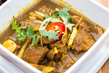 Indian curry lamb rogan josh in a white bowl Stock Photo - 37728116