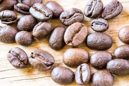 wooden floors: Coffee beans closeup on wooden floors.