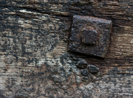 hard component: Nut and bolt on a wooden background. Close up detail. Stock Photo