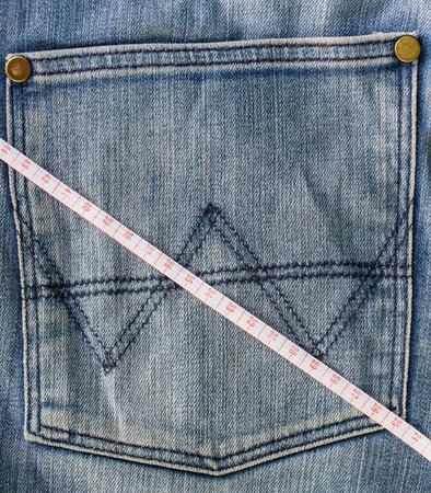 decreasing in size: Jeans and measuring tape Stock Photo