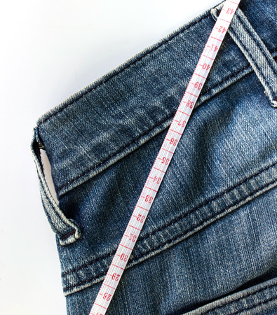 Jeans and measuring tape photo