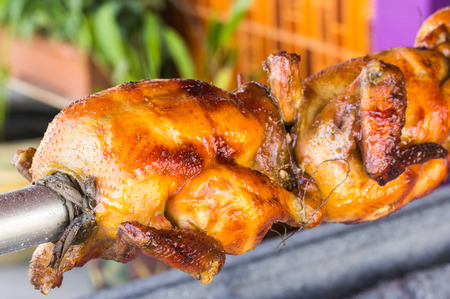 appetizing: appetizing toasted chicken in charcoal grills