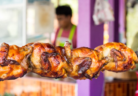 appetizing: appetizing toasted chicken in charcoal grills beside papaya salad Shop