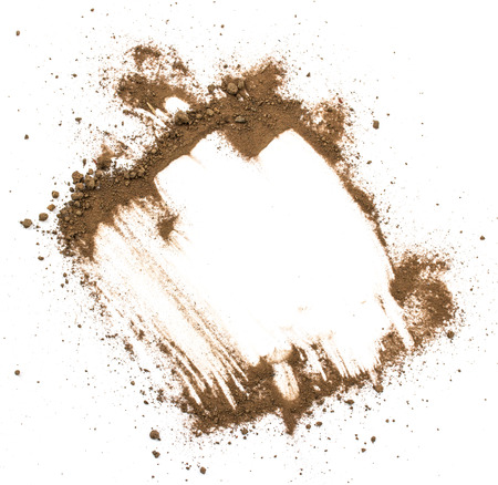 Vuile aarde op een witte achtergrond. Natuurlijke bodemtextuur Stockfoto
