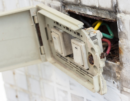 defective electrical wall fixture.Danger of Use Stock Photo - 42213073