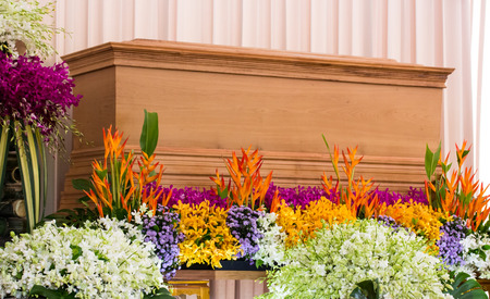 mortician: Religion, death and dolor - funeral and cemetery; funeral with coffin with flowers
