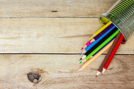 tin can: color pencils in tin can on wood Stock Photo