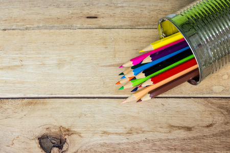 color pencils in tin can on wood Stock Photo