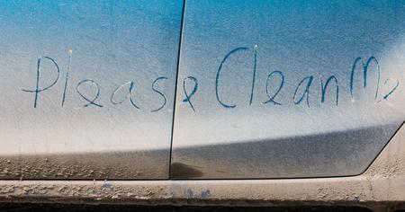dirty car: Clean me written on a dirty car