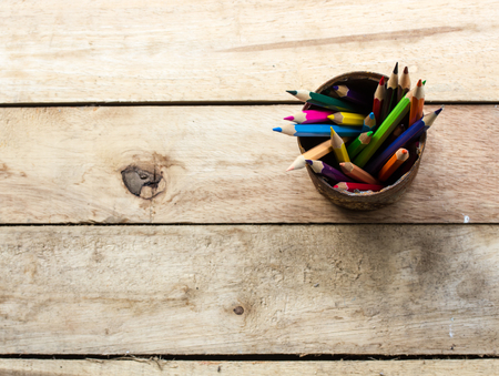 color pencils: color pencils in rusty tin can, wood table