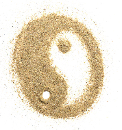 Universal symbol yin yang sculptured in sand
