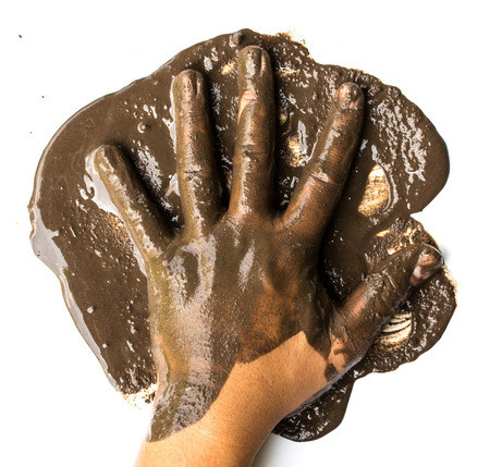 Hands with mud on white