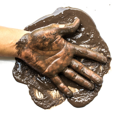 10 fingers: Hands with mud on white