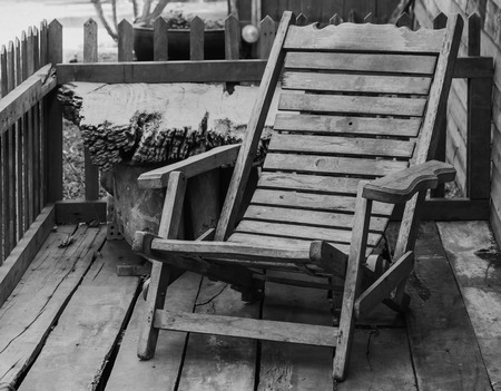 reclining chair: Old Wooden reclining chair in a garden