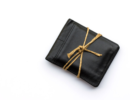 preventive: black leather wallet with ropes on white background.The concept of preventive care for money.