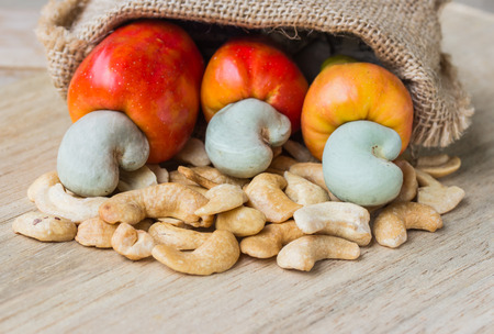 raw cashew nuts Fresh Cashew Nut pour from sack on wood