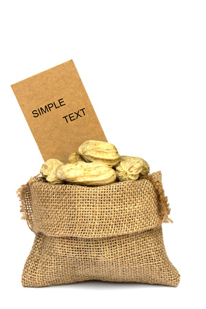 burlap bag: peanuts and price tag in burlap bag on white Background Stock Photo