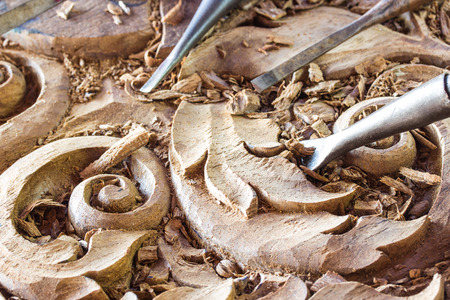 carpenter's sawdust: a wood carvings, tools and processes work closeup